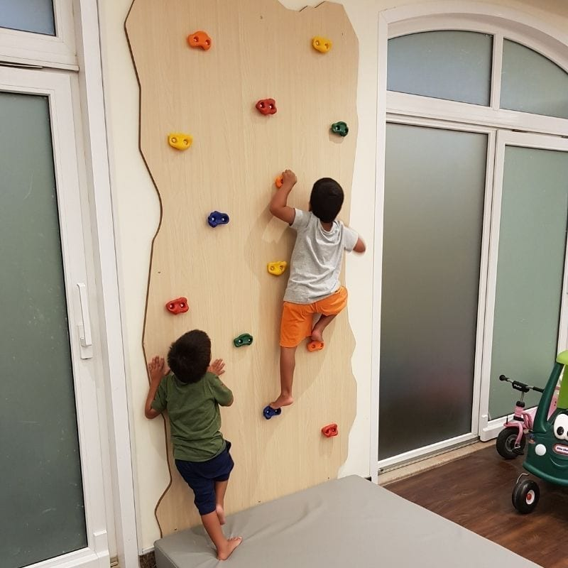 Rock Face Climbing Wall with Children Climbing